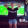 Немецкая фотомодель Хайди Клум не верит в фантастическую игру сборной Германии, разгромившей Бразилию 7:1
