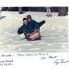 Ретрофото. Арнольд Шварценеггер и Джордж Буш-младший катаются на санках. США. 1991 год