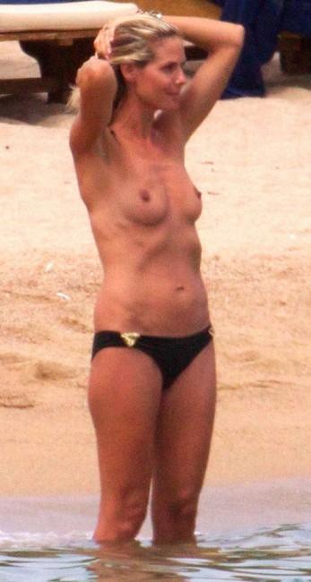 Модель Хайди Клум загорает с голой грудью